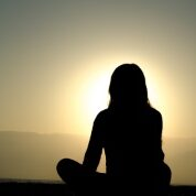 woman-meditating-at-sunset